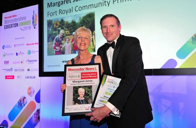 Mike Wigmore presents Margaret Jones with her award at the Worcester News Worcestershire Education Awards 2019, held at the University of Worcester Arena. Pic Jonathan Barry 20.6.19.