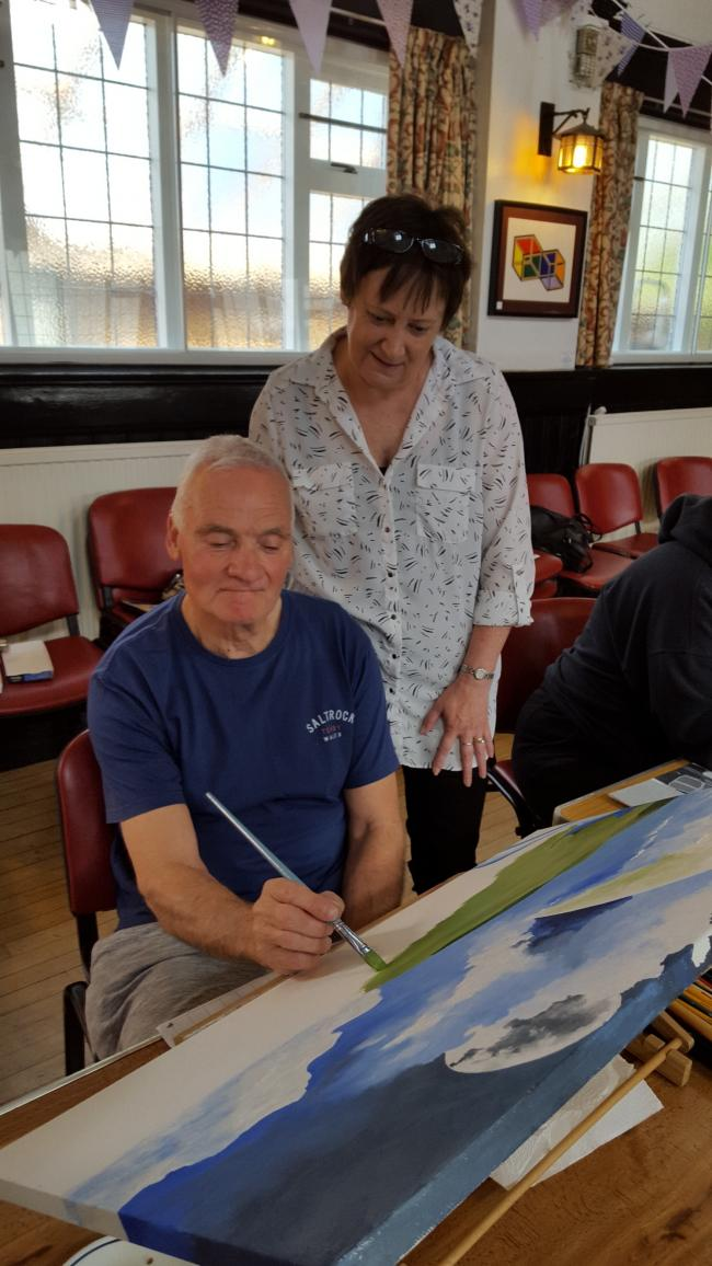 Local artist Dennis Hill (left) with tutor Pam McGregor