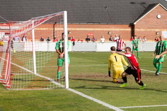 Evesham United's Lee Chilton celebrates his goal against Winchester City. Picture: stuartpurfield.co.uk