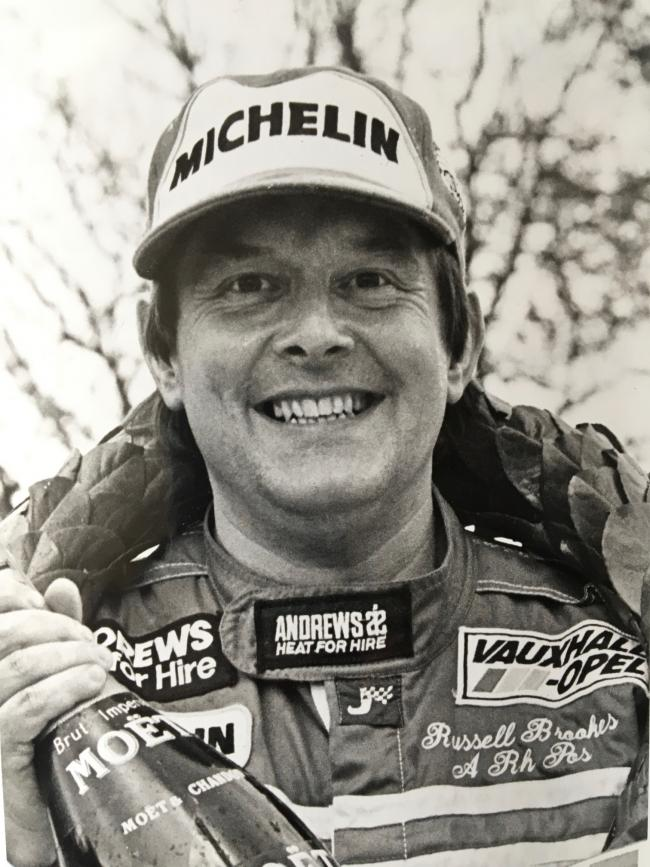 Russell Brookes celebrating his 1987 Welsh Rally victory