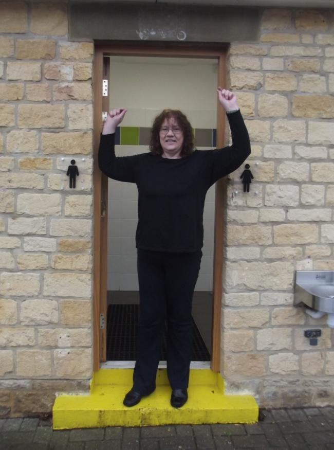 Cllr Emma Stokes celebrates Wychavon's success at the Loo of the Year Awards outside the Church Close toilet in Broadway