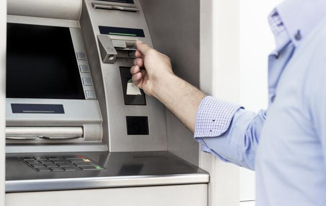 Free cash machines could soon disappear - pic. Getty