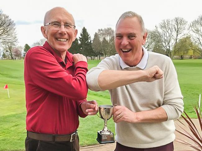 Evesham seniors' captain Les Bond presents the trophy to winner John Richards. Picture: MICK HOCKING