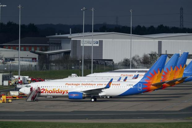 Evesham Journal: AIRLINE: Several Jet2 planes have been parked up at Birmingham Airport during the pandemic. Picture: Steve Parsons/PA