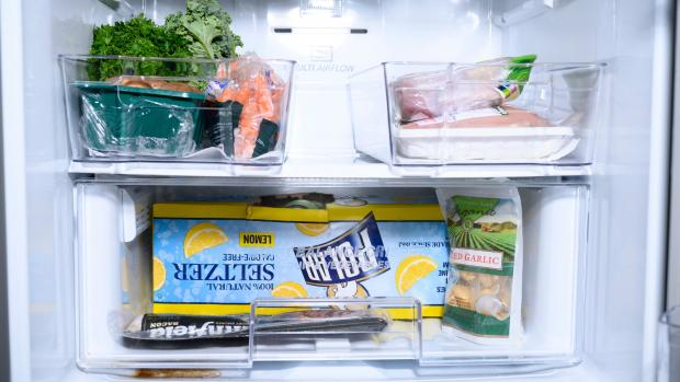 Evesham Journal: We lined the bottom of the fridge bins with kitchen towel—you can also use fridge mats. Credit: Reviewed / Betsey Goldwasser
