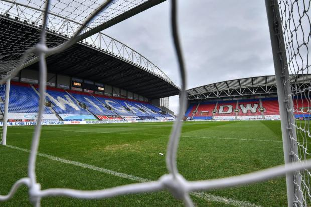 Wigan will play in League One next season (Anthony Devlin/PA)