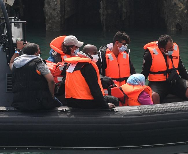 ABOARD: A group of people thought to be migrants are brought into Dover, Kent, by Border Force officers following a number of small boat incidents in the Channel yesterday.