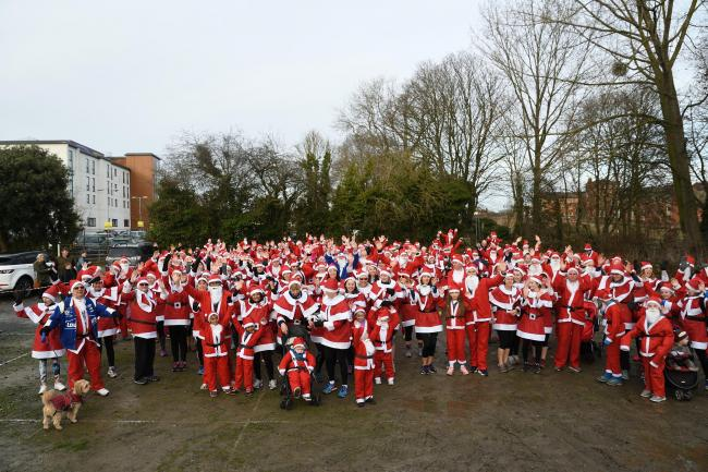 RUNNING: Runners in last year's Santa Dash. Pic. Axiom Pictures