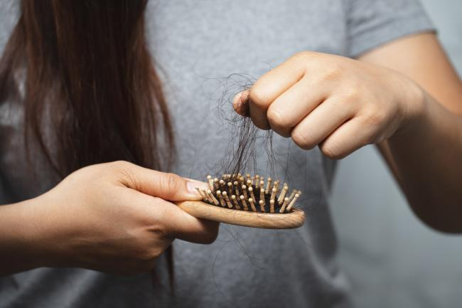 Almost a quarter of Covid patients suffer hair loss - with women at greater risk. (Canva)
