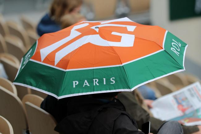 A fan at the French Open holds an umbrella