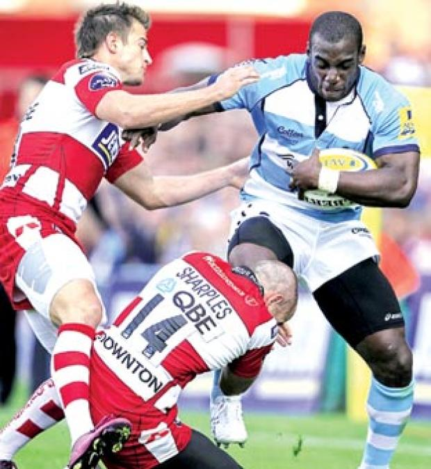 FLASHBACK: Warriors wing Miles Benjamin bids to break the Gloucester defence during his side's 29-8 defeat at Kingsholm last September.