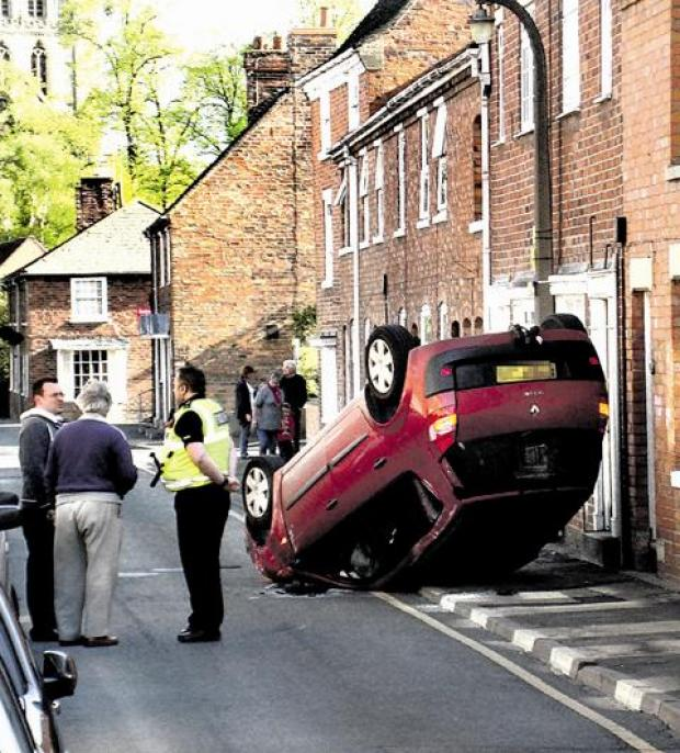OVERTURNED: The car on Priest Lane, Pershore (picture by Owen Griffiths)