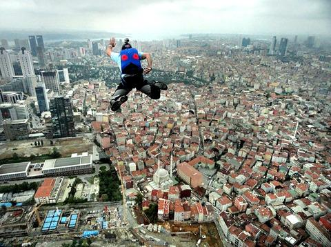 FLYING HIGH: Spencer Hogg jumps from the 236-metre building in Istanbul, Turkey.