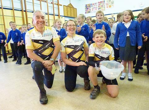 Jake Phipps with Philip Woods and mum Nic Phipps at St Richard's First School.