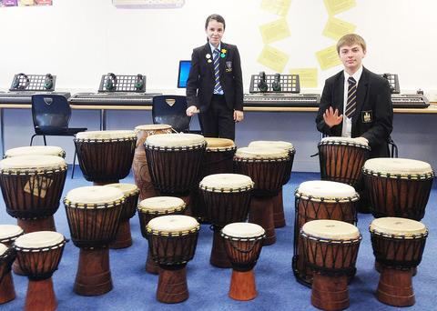 BEAT THIS: Alice Smith, aged 11, and James Cameron, 15, play the bongos in their new arts centre.