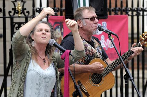 ON SONG: Farcical (Sally Stamford and Arthur Hyde) perform outside the Guildhall. Worcester