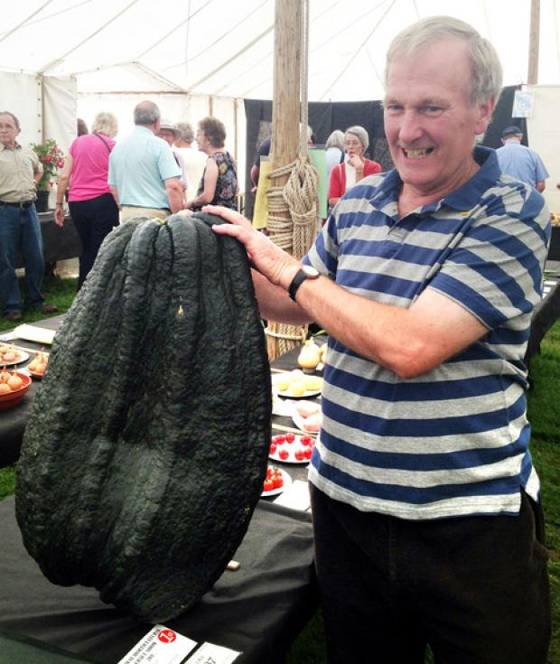 Martin Enstone proudly displays his giant marrow.