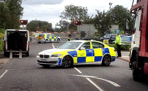 Police close the railway crossing between Honeybourne and Evesham after the man's death.