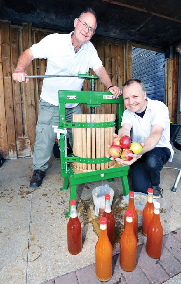 Above: Arthur Rowe and Rod Howell with their cider press. Picture by John Anyon. BUY THIS PHOTO: worcesternews. co.uk/pictures/sales. 37130901