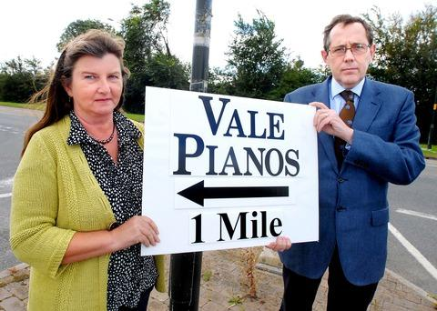 POINTER: Linda Lowe, the owner of Vale Pianos and MP Peter Luff with the sign that the council says must be removed, or the business will be fined.