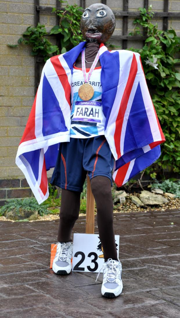 HONOURED: Mo Farah as a scarecrow