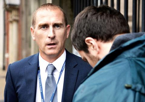 PLEASED: Detective Inspector Carl Moore talks to reporter James Connell (39138905)