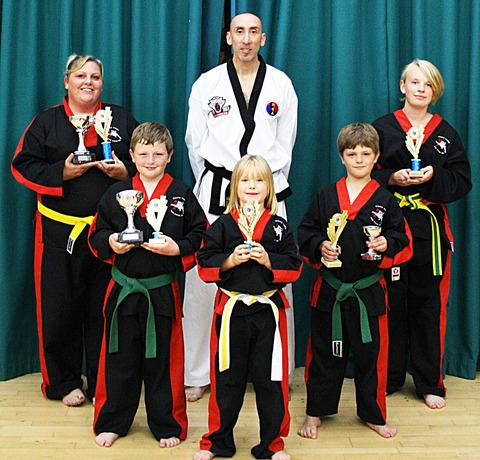 TIGERS ROAR: White Tiger Tae Kwon-Do and Self Defence Club members line up after trophy success. Back row (from left): Sarah Boden, Paul Wanklyn and Gemma Ranford. Middle: Jake Boden and Bradley Boden. Front: Ruby Keen.