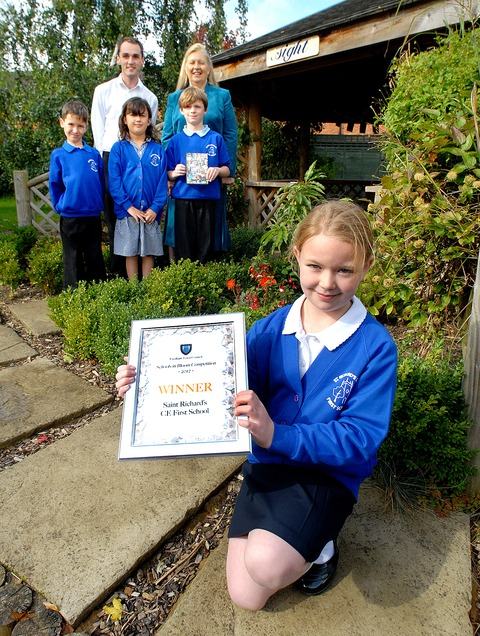 AWARD: Nicola Sinclair, aged nine, front, and, back
