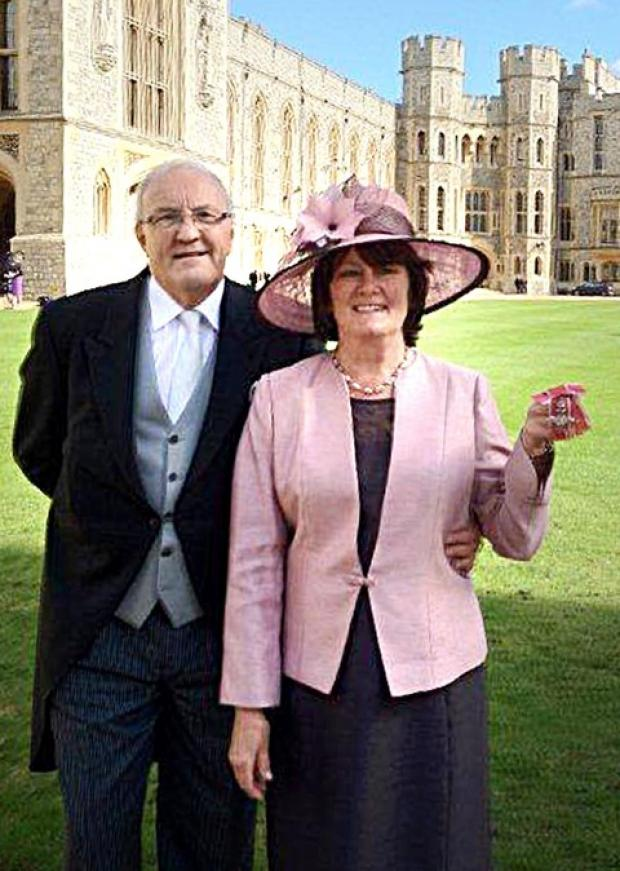 ROYAL APPROVAL: Ralph and Elizabeth Bolland at the palace.