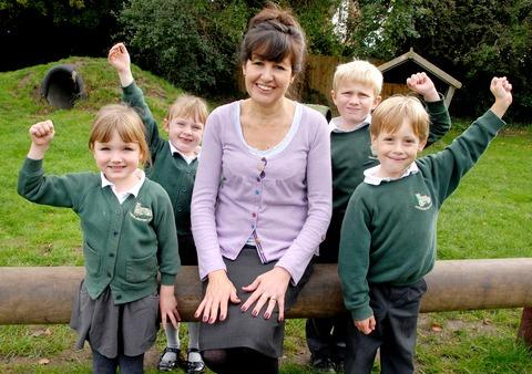 SCHOOL REPORT: Anne Freer, the headteacher of Church Lench First School – deemed 'outstanding' by inspectors – with pupils Grace Clarke, aged five, Amelia Smith, six, Owen Bates, seven, and Daniel Reynolds, seven.