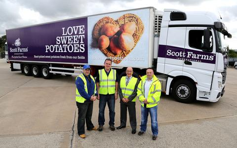 From left are Darren Smith (Scott Farms International), Jonathan Kelly (Spiers & Hartwell), Stan Smith (Scott Farms International) and Simon Hobbs (Scott Farms International) with one of the new Love Sweet Potatoes lorries.