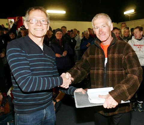STEEP CHALLENGE: Keith Davis (right), who finished 459th overall, receives his prize from former Snowdonia Marathon winner Jeff Norman who holds the course record.