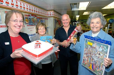 ACHIEVEMENT: From left, shop manager Sue Allen, area organiser Lyn O'Toole and John and Pat Ogle mark 21 years of seasonal fund-raising. Picture: Nick Toogood. 44165802