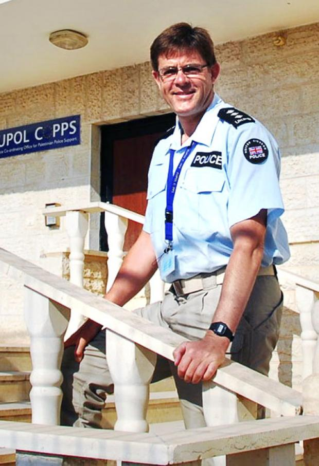 NEW UNIFORM: Retired West Mercia chief inspector Andrew Udall is all set to enjoy a fresh challenge in Palestine.