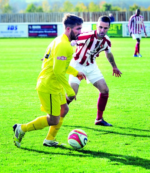 BACK IN CONTENTION: Evesham United's Simon Fitter (back) made his return from a three-match ban on the bench in his side's home goalless draw with Cirencester Town.