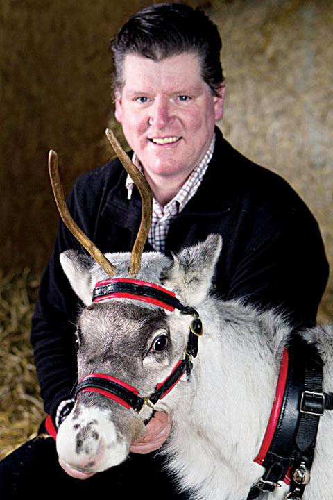 FAKING IT: Trevor Hall, of Bromyard, with reindeer Kate, who is wearing the antler wig.