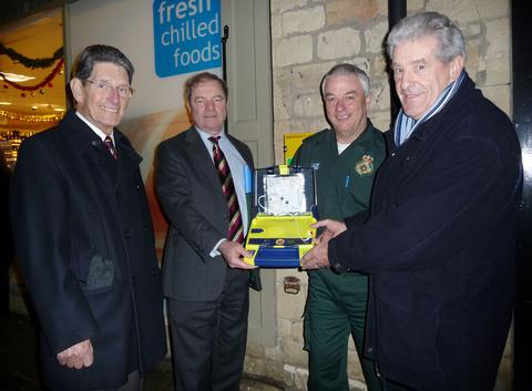 HANDOVER: From left, John Franklin, parish council chairman, Geoffrey Clifton-Brown MP, Kevin Dickens of Great Western Ambulance Service and Barry Metcalfe, project leader.