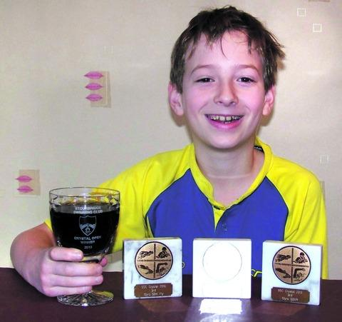 COUNTY STANDARD: Pershore Swimming Club's Chris Vizard, 10, celebrates an impressive Stourbridge Crystal Open display with a soft drink in the winner's goblet. His strong showing included a victory in the 50-metre backstroke. Picture: IAN PUGH