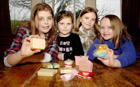 SOAP CURE: Millie Tanner, aged 11, left, with her sisters Scarlet, six, Elouse, nine, and India, eight, with goats' milk soap made by their mother Lisa Tanner.
