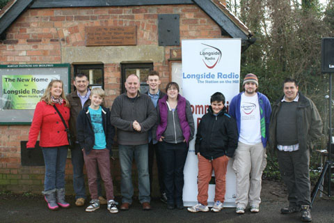 READY TO HELP: Mark Tibbutt, second left, with some of the people who came to the new home of Longside Radio.