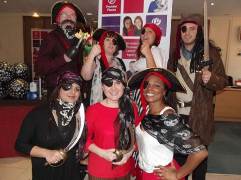 COME ON ME HEARTIES: Staff from Premier Places dressed as pirates in a bid to raise treasure chests full of cash