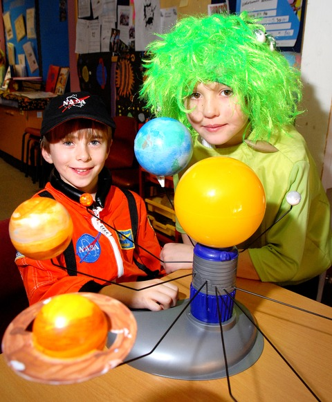 OUT OF THIS WORLD: Maxim Plowman, aged 10, and Harry Harland, nine, dressed up as part of St Nicholas Middle School's space topic. Picture by Paul Jackson. 0713246501