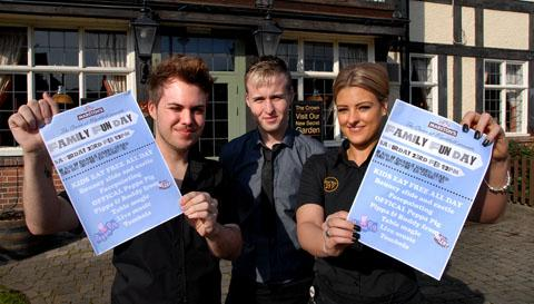 Remembering Charlie: Luke Martin, Jonathan Buckley and Francesca Woods prepare for the fund-raiser at the Crown pub in Wychbold, near Droitwich. BUY THIS: 0813249901.