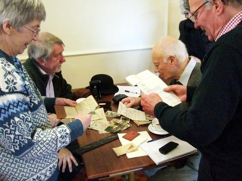Residents take a look at a range of archive material that has been unearthed in Mickleton after the Community Archive project captured the imagination of the village