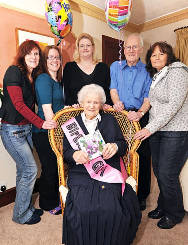 CENTRE OF ATTENTION: With Rosa Hyde are, from left, granddaughter Marie Jaques, great-granddaughter Victoria Walsh, granddaughter Esme Rafter, son Trevor Hyde and daughter Patricia Rafter. 0913257502