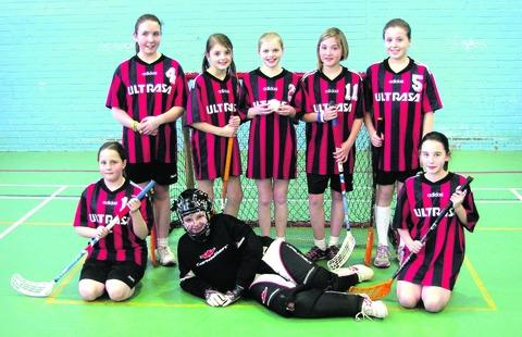 TOP HONOURS: Cotswold Floorball League girls' champions St Davids line up for the camera. Picture: ANDREW CLOUGH
