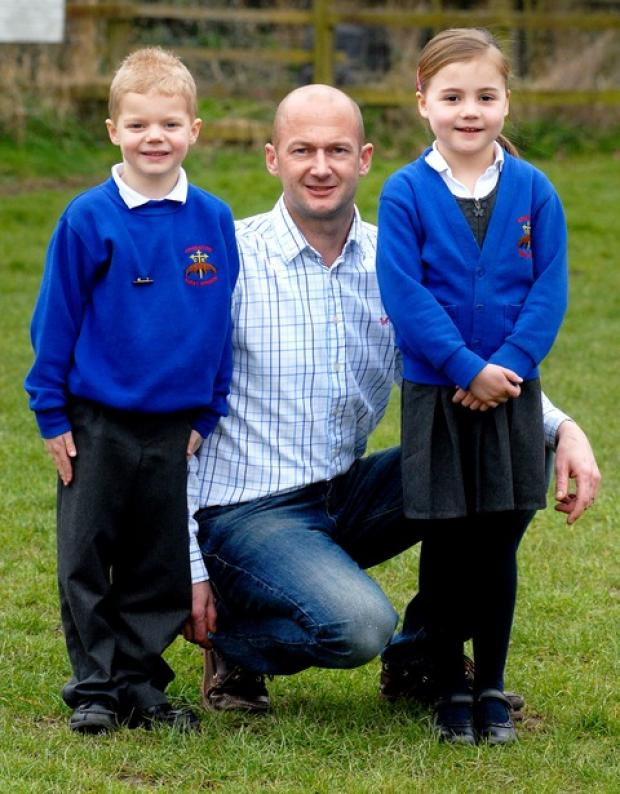 CHARITY CHALLENGE: William Leighfield, aged six, with his dad Steve and friend Georgina Cook, five. 1213274201