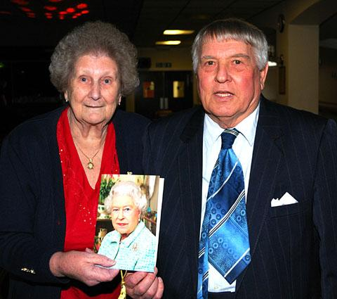 CONGRATULATIONS: Jean and Ken Edwards with their card from the Queen.
