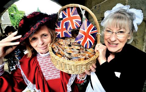 GOODIES: Gill Butler and Jo Rolfe, of Malvern Museum Association, at last year's Great Malvern Food Festival. 22052201