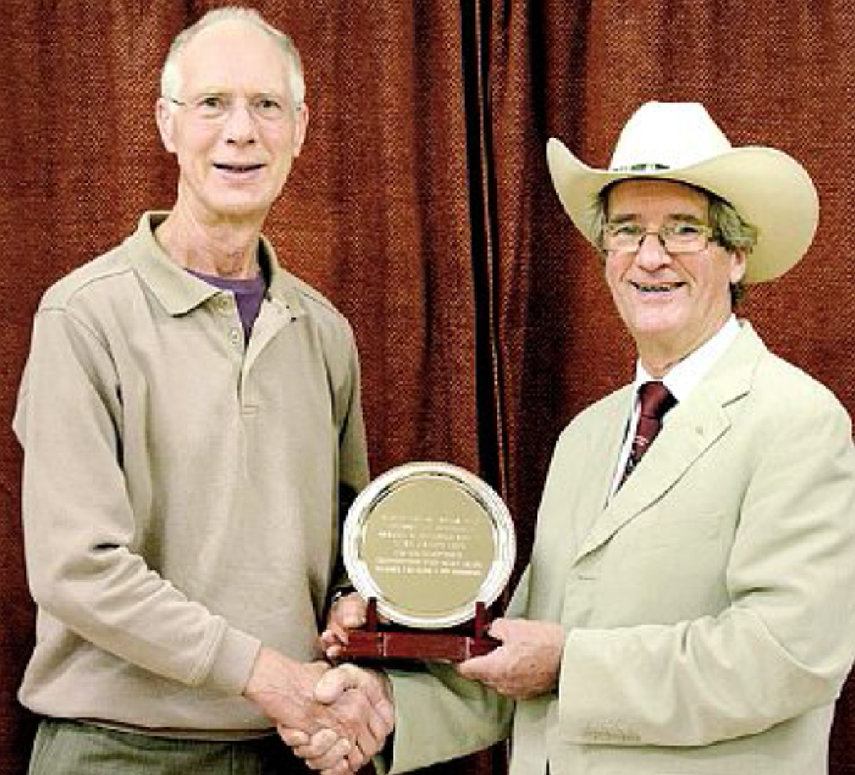 Clive Haynes receiving his award